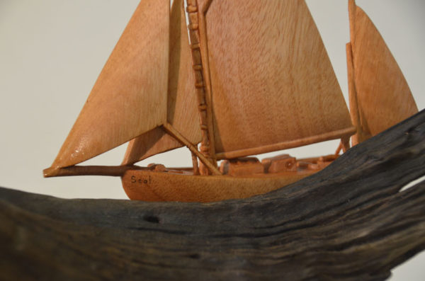 Classic sailboat wood carving from marine artist Radha Pedersen